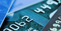 4 credit cards overlapping each other