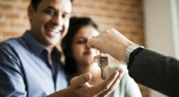 Couple receiving keys to their home
