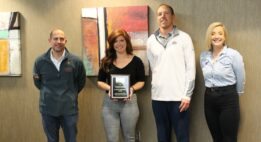 Sioux Empire United Way presents Business of the Year award to Julie Engebretson and Jason Appel