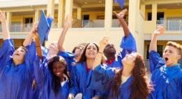 Graduates tossing their caps in the air