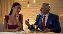 Old Man Proposing To Attractive Young Woman and her not looking enthused