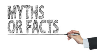Person writing Myths or Facts on a whiteboard
