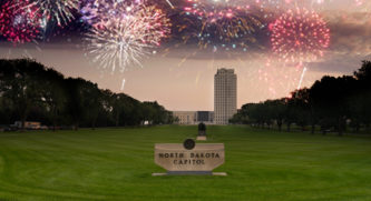 North Dakota Capitol In Bismarck With Fireworks